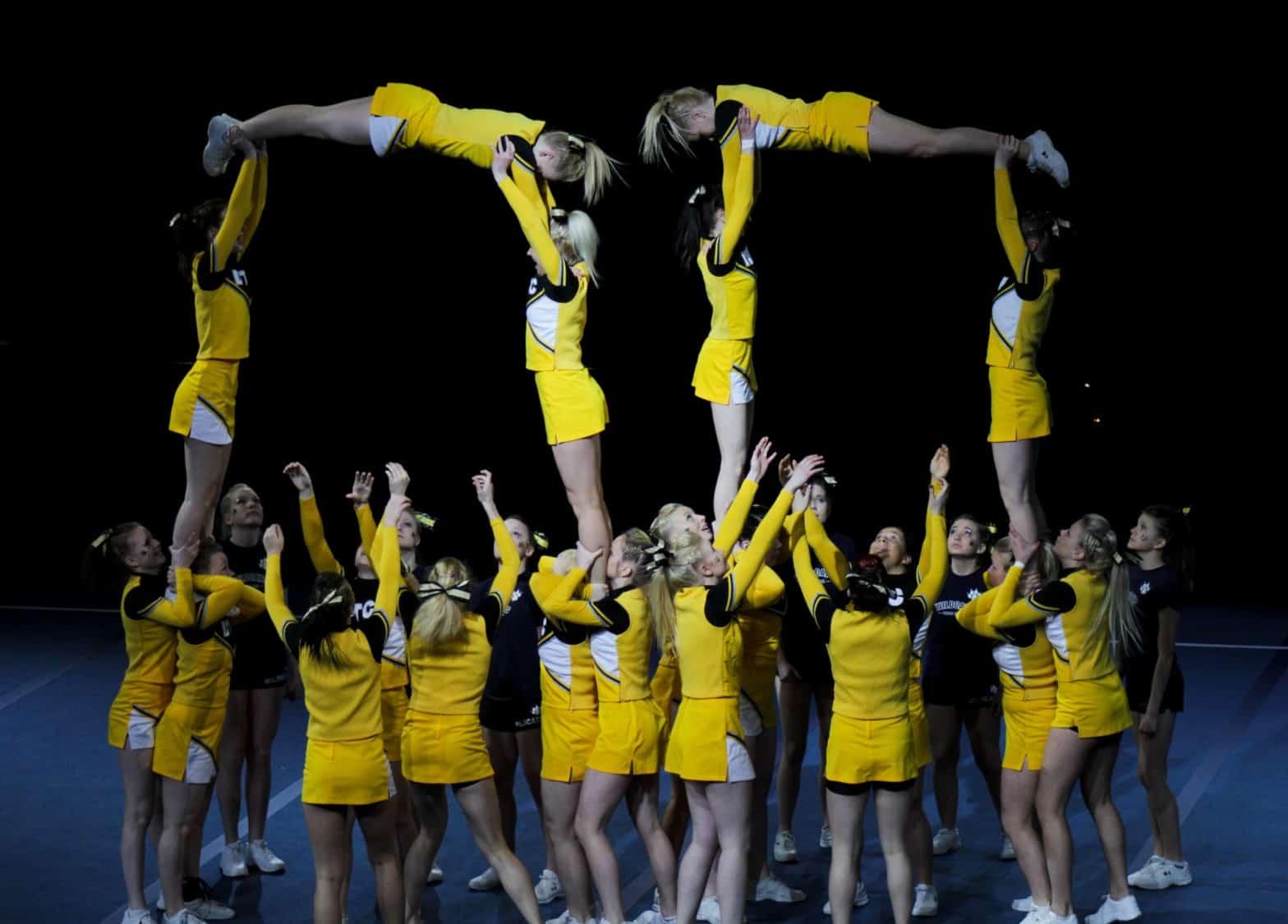 Cheerleaders holding up cheerleaders holding up cheerleaders